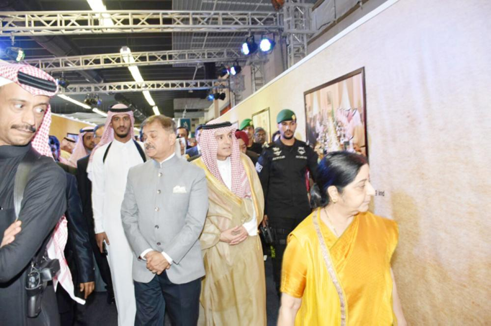 Adel Al-Jubeir, Sushma Swaraj and Indian Ambassador Ahmad Javed tour the Indian pavilion at Janadriya.