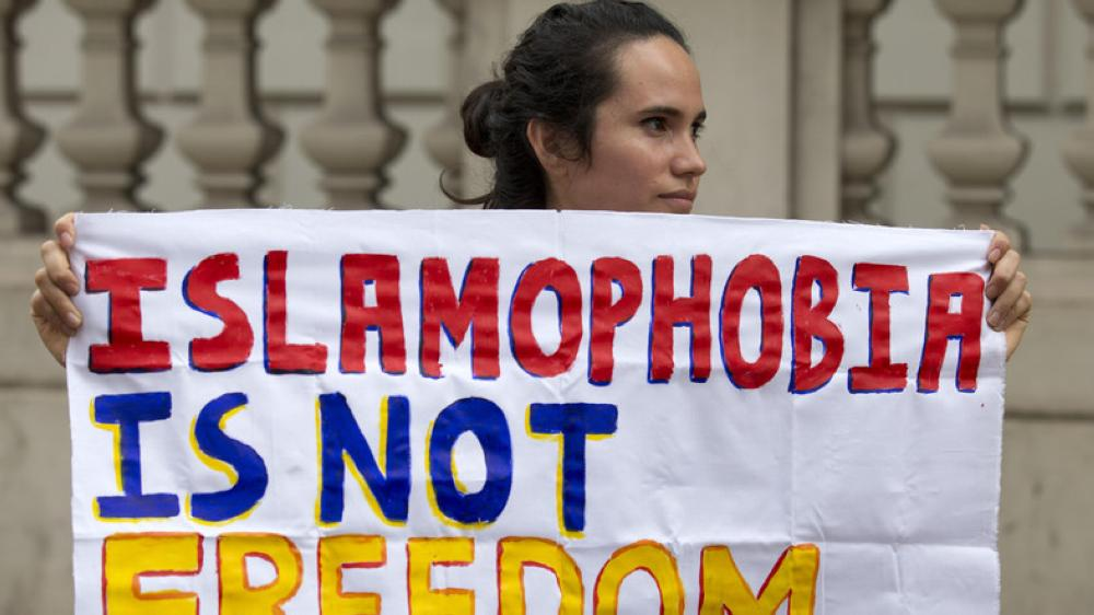 """A protester holds a sign which reads """"Islamophobia is not freedom"""" outside the French Embassy in London in this file photo. — AFP"""