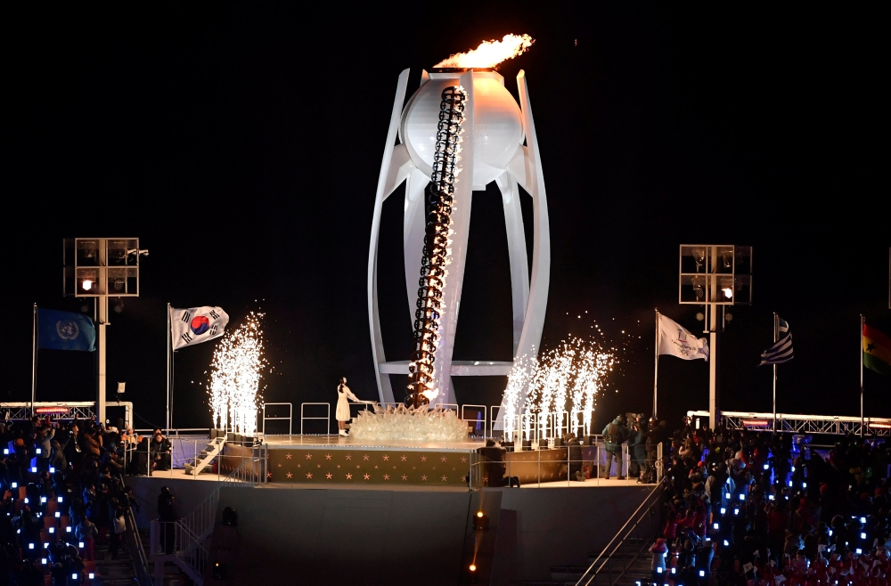 Former figure skater Yuna Kim of South Korea lights the cauldron during the opening ceremony of the Pyeongchang 2018 Winter Olympics at the Pyeongchang Olympic Stadium, Pyeongchang, South Korea on Friday. — Reuters