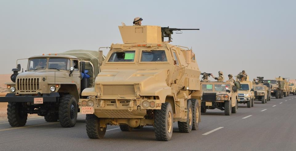Egyptian Army's Armoured Vehicles are seen on a highway to North Sinai during a launch of a major assault against militants, in Ismailia, Egypt, in this undated handout picture made available by the Ministry of Defense Friday. — Reuters