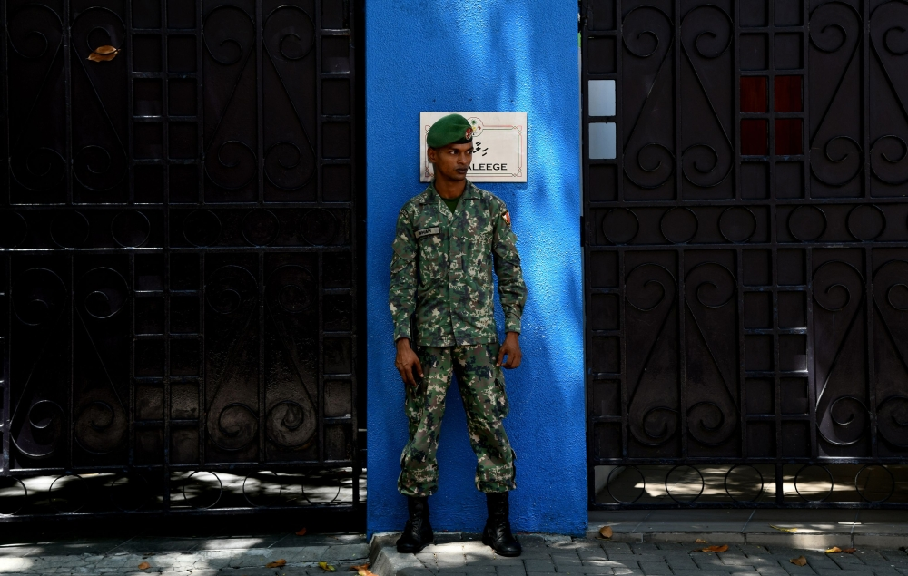A Maldives soldier stands guard outside the president's residence in Male in this Feb. 8, 2018 file photo. — AFP
