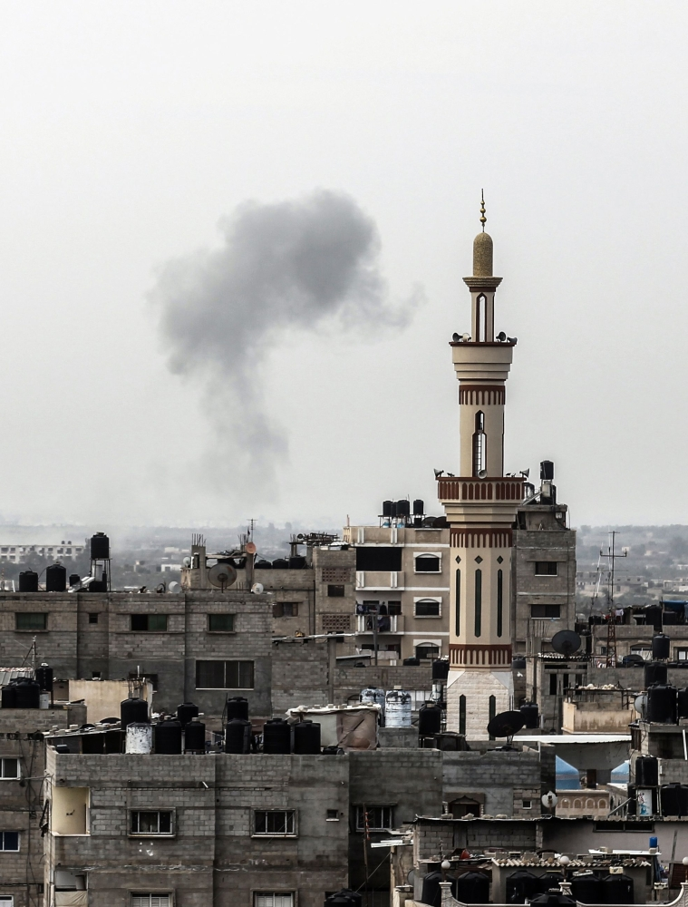 A picture taken from Rafah in the southern Gaza Strip shows smoke billowing on the Egyptian side of the border following an explosion. Egypt closed its border with the Gaza Strip, Palestinian officials said, after Cairo launched a major operation against militants in the Sinai Peninsula. — AFP