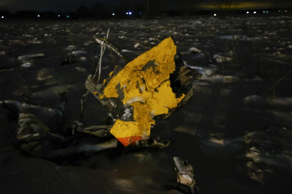 A part of a Saratov Airlines Antonov AN-148 plane that crashed after taking off from Moscow's Domodedovo airport is seen at the scene of the incident outside Moscow on Sunday. -- Reuters