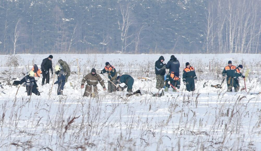 Russian Emergency Situations Ministry members work at the crash site of the short-haul AN-148 airplane operated by Saratov Airlines in Moscow region, Russia, on Monday. — Reuters