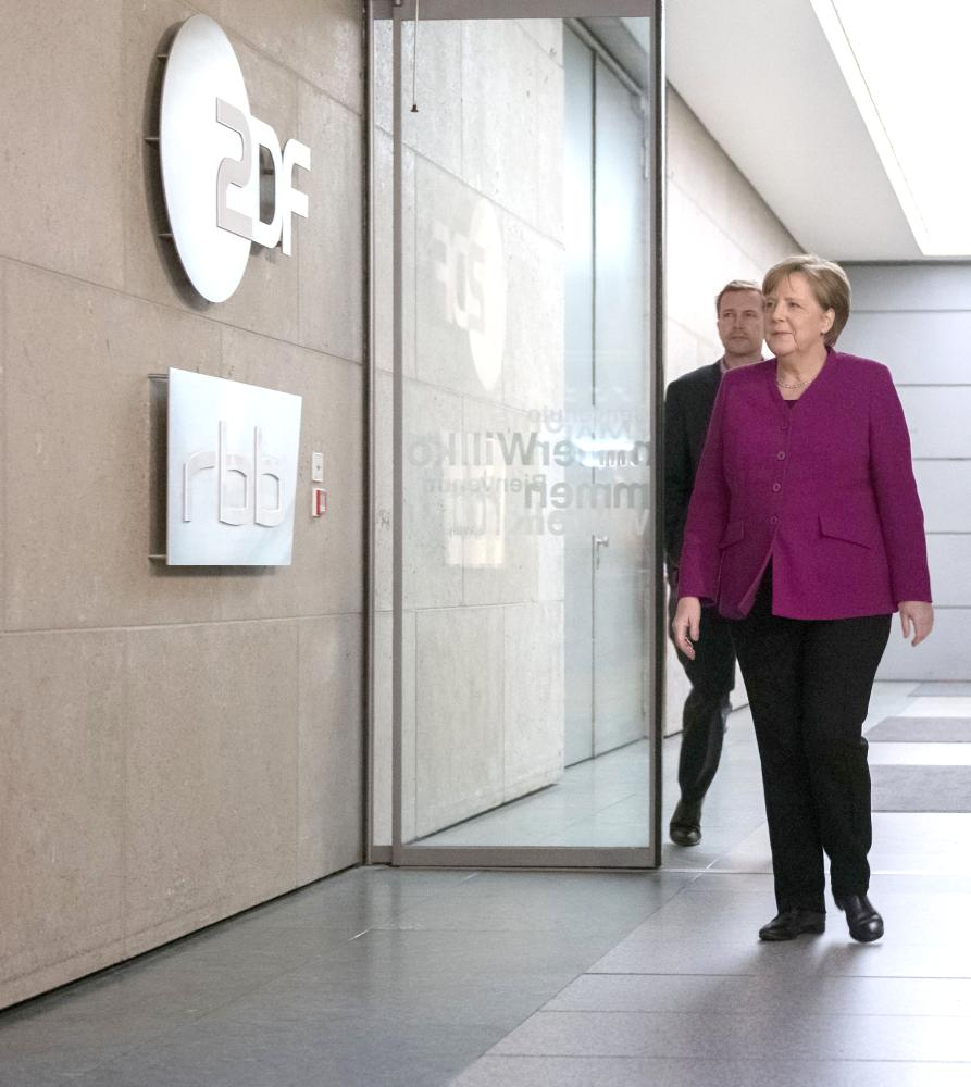 "German Chancellor and leader of the Christian Democratic Union (CDU) Angela Merkel arrives at the recording of the ZDF program ""Berlin direct"" in the ZDF studio in Berlin on Sunday. — AFP"