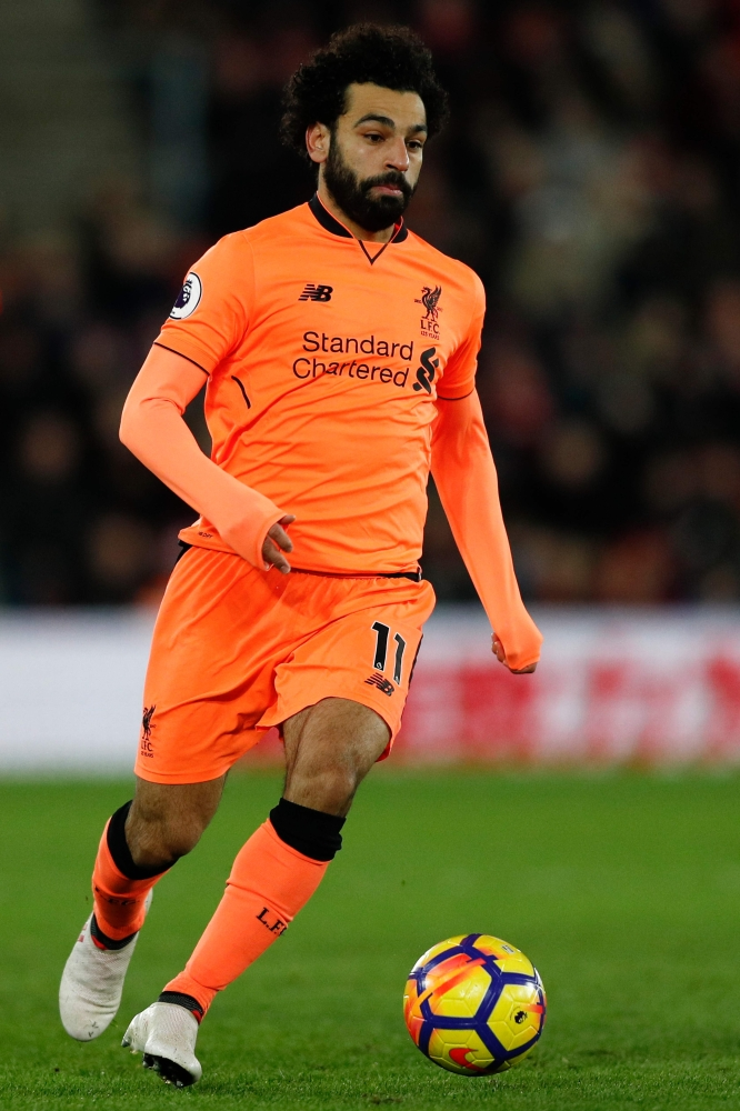 Liverpool's Egyptian midfielder Mohamed Salah runs with the ball during the English Premier League football match between Southampton and Liverpool at St Mary's Stadium in Southampton, southern England. — AFP