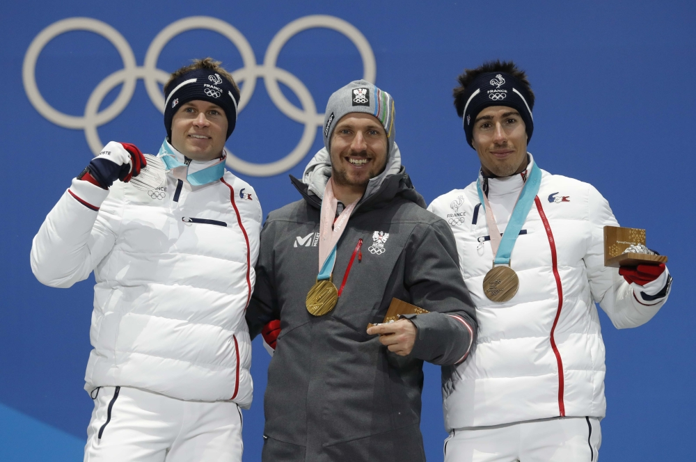 Gold medalist Marcel Hirscher of Austria, silver medalist Alexis Pinturault of France and bronze medalist Victor Muffat-Jeandet of France on the podium after the Men's Alpine Combined at the Pyeongchang 2018 Winter Olympics on Tuesday. — Reuters