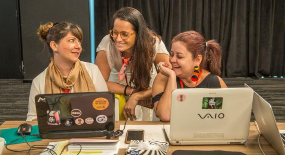 María Cristina Arboleda Puente, left, and Isabel Cristina González Ramírez, right, from Ecuador's Sentimos Diverso attend Chicas Poderosa's New Ventures Lab, hosted by Google in Sao Paulo, Brazil on Feb. 1, 2018. - Thomson Reuters Foundation