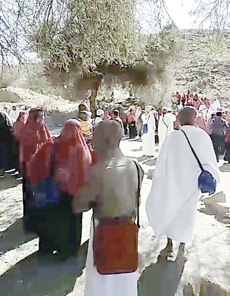 Some pilgrims are seen kissing a tree that they considered to be holy in village in Taif. — Okaz photo