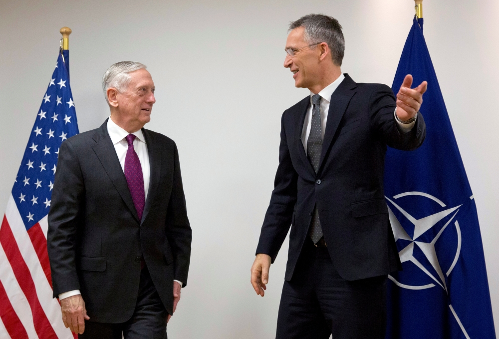 NATO Secretary-General Jens Stoltenberg welcomes US Secretary of Defense Jim Mattis during a NATO defense ministers meeting at the Alliance headquarters in Brussels, Belgium, on Wednesday. — Reuters
