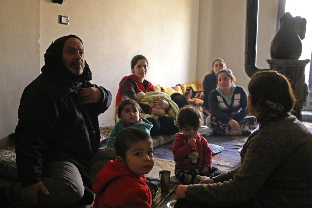 Members of seven displaced Syrian families gather in an apartment in the Kurdish Syrian town of Afrin where they are all taking shelter after fleeing from a three-week assault by Turkey and allied Syrian rebels on towns and villages along the border in northern Syria. The United Nations estimates that between 15,000 to 30,000 have been displaced by the Turkish-led offensive to other parts of Afrin district.  — AFP photos