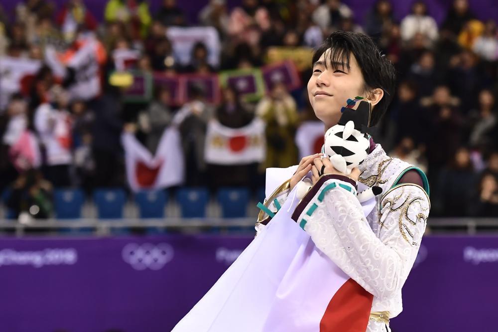 Gold medalist Japan's Yuzuru Hanyu celebrates after the men's single skating at the Pyeongchang 2018 Winter Olympic Games Saturday. — AFP