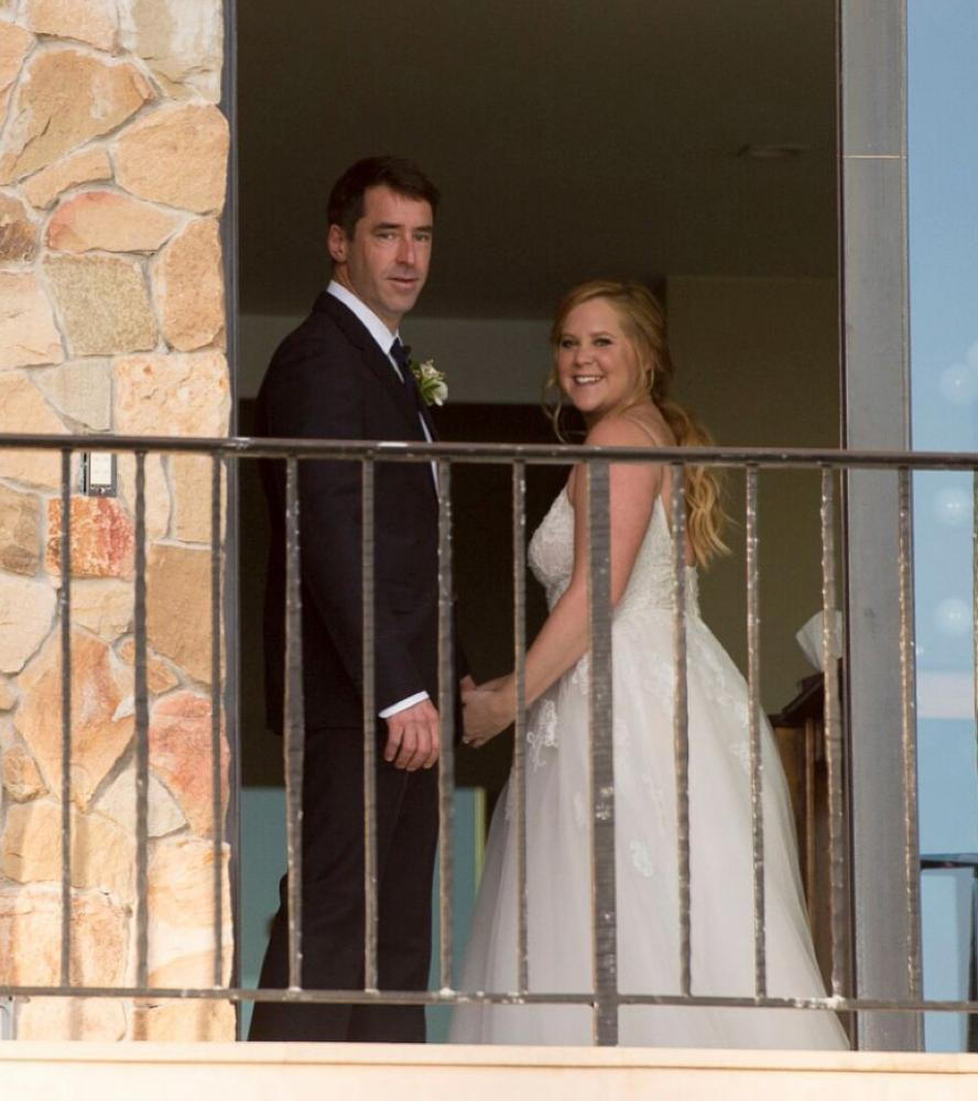 Amy Schumer and Chris Fischer pose after their wedding ceremony in Malibu, California.