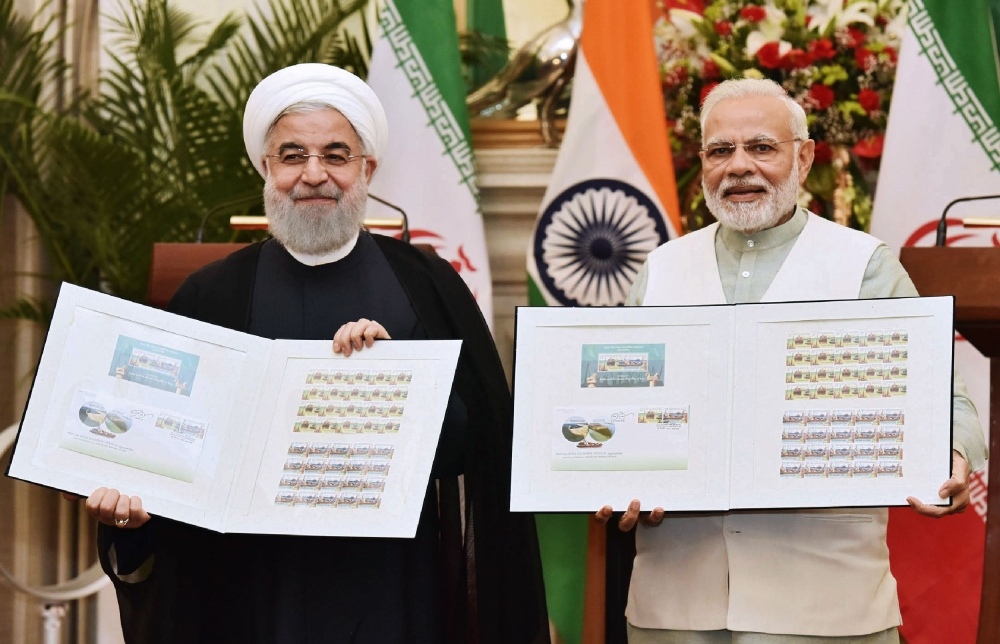 Indian Prime Minister Narendra Modi, right,  and Iranian President Hassan Rouhani release the commemorative stamp celebrating India-Iran relations at Hyderabad House in New Delhi on Saturday. — AFP