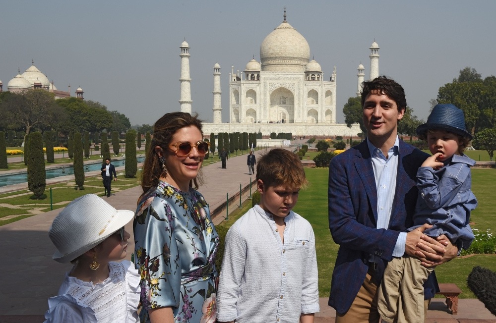 Prime Minister of Canada Justin Trudeau talks to the media during a visit to the Taj Mahal with his wife Sophie Gregoire and their children, in Agra on Sunday. — AFP