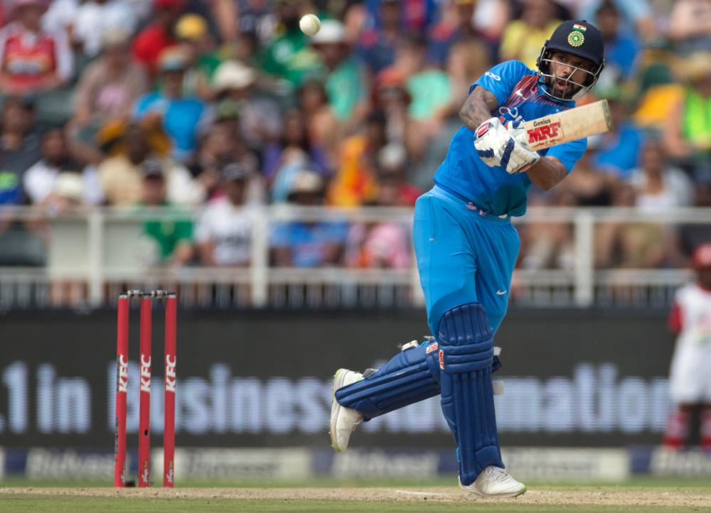 India's Shikhar Dhawan plays a shot against South Africa during their first T20 International match at The Wanderers Stadium, Johannesburg, Sunday. — Reuters