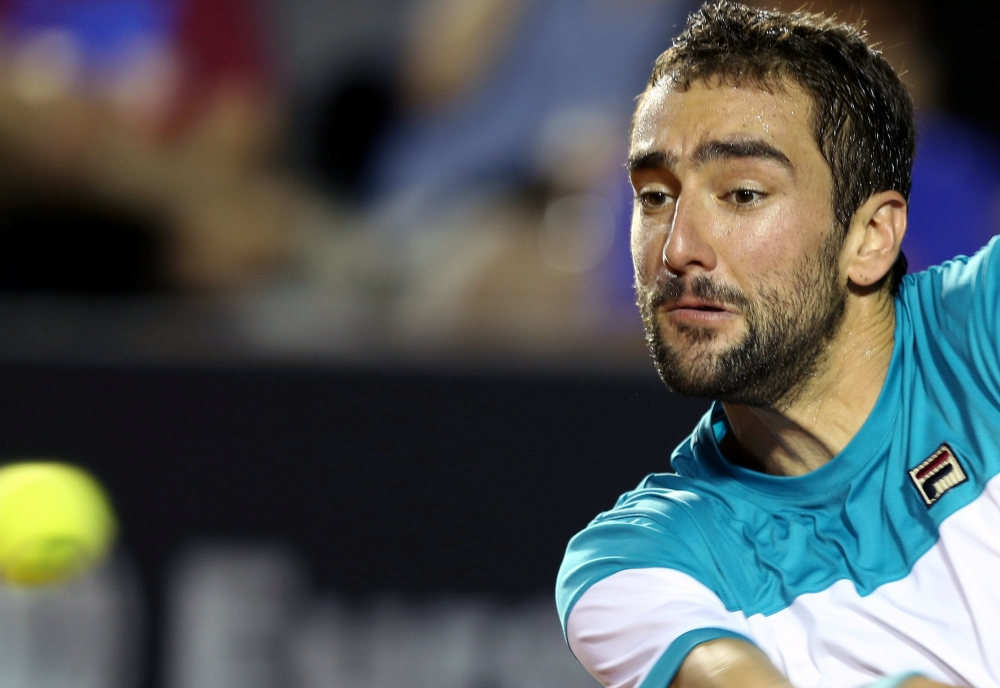 Marin Cilic of Croatia in action against Carlos Berlocq of Argentina at the ATP 500 - Rio Open 1st round in Rio de Janeiro, Brazil, on Monday. — Reuters