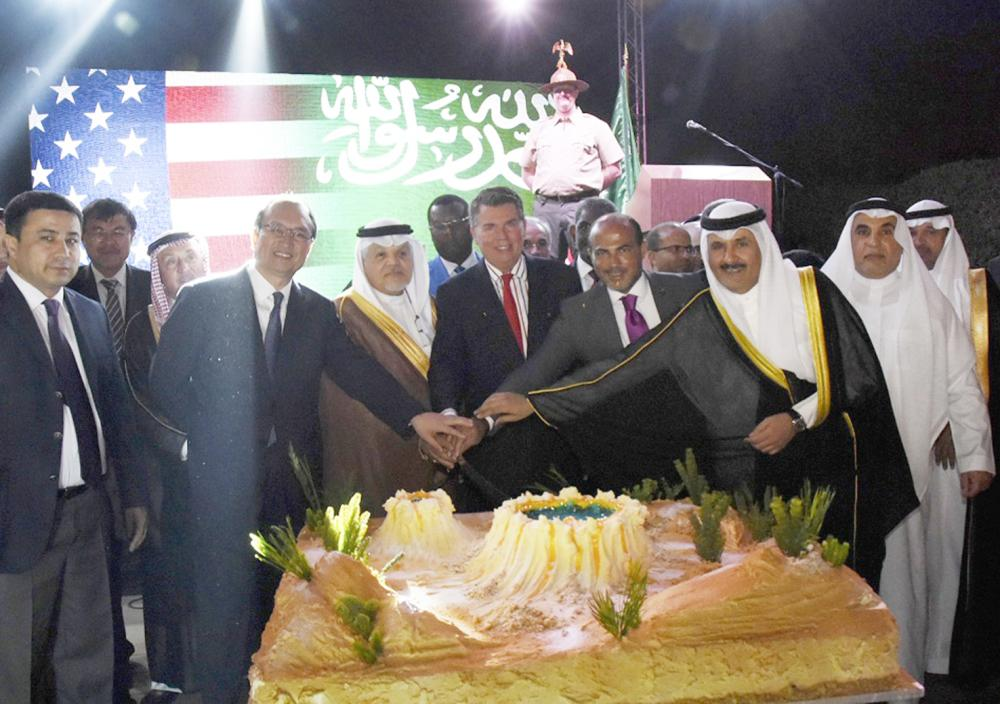 Consul General Mitman, Ambassador Jamal Balkhoyour, and dignitaries from the diplomatic corps gathered for the cake cutting ceremony at the U.S. Consulate General Jeddah.