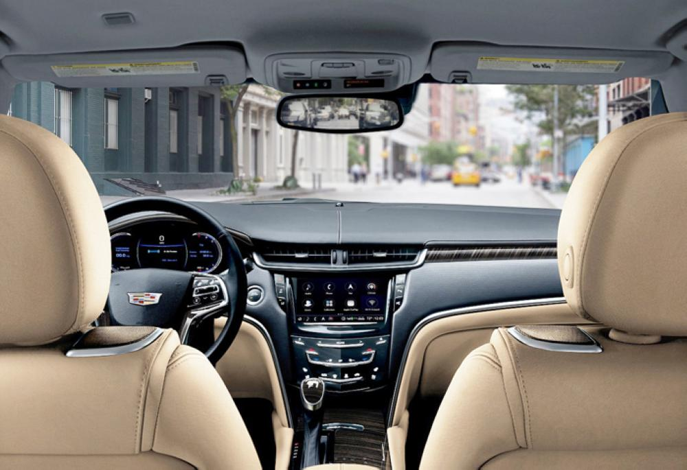 The 2018 Cadillac XTS luxury sedan is elevated with the new generation of design and technology. XTS Platinum shown here in the all-new Maple Sugar interior environment with Jet Black accents and Nutella Lineate with high gloss Ebony Lineate wood trim.