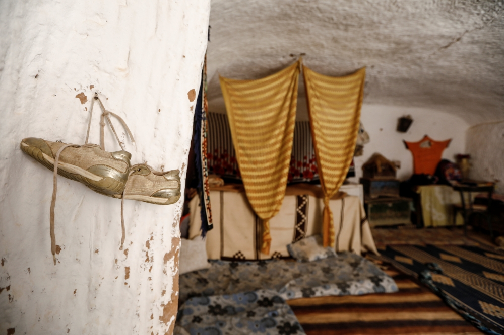 A pair of shoes hang on the wall of a troglodyte house on the outskirts of Matmata, Tunisia. — Reuters photos