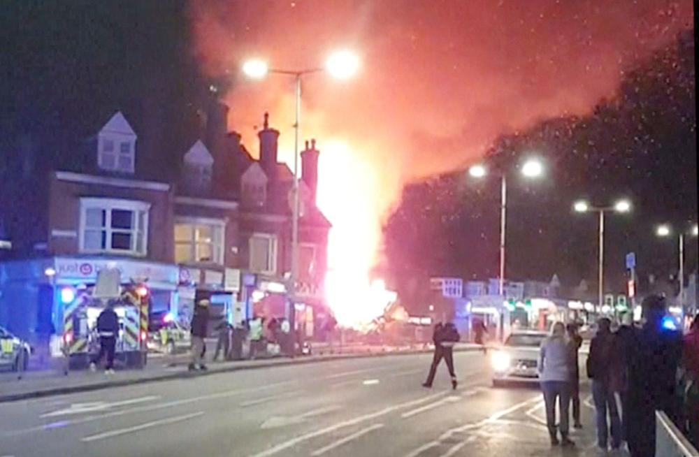 A screen grab taken from a video obtained from the Facebook account of Graeme Hudson shows a fire burning after an explosion in Leicester, England, on Sunday. — AFP