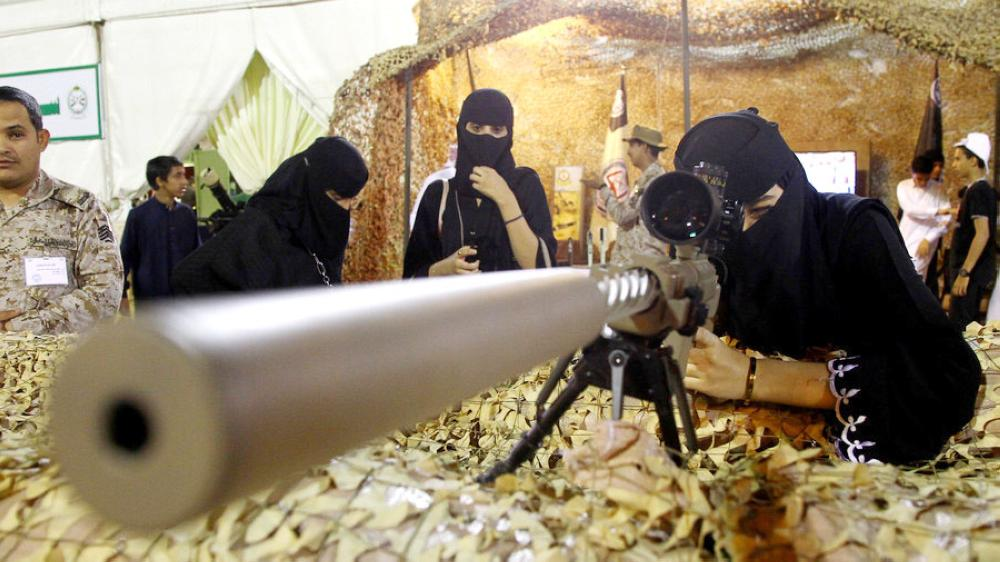 A woman checks a weapon exhibited at an event to celebrate the selection of Abha as the capital of Arab tourism for the year 2017, in this April 20, 2017, file photo. — Reuters