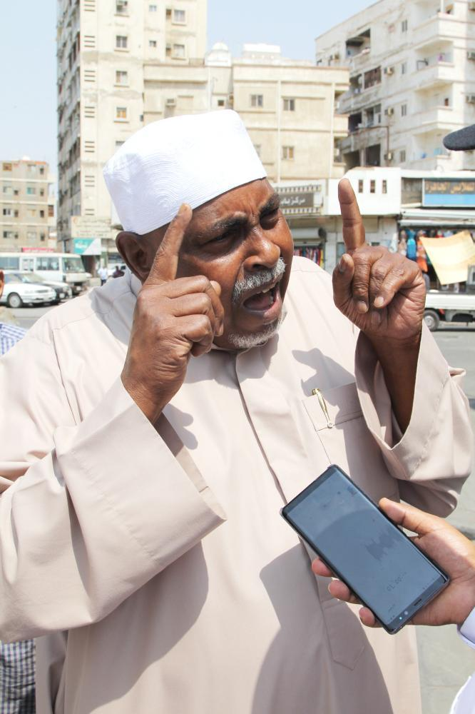 Ali Al-Zahrani, a minibus driver, expresses his anger.
