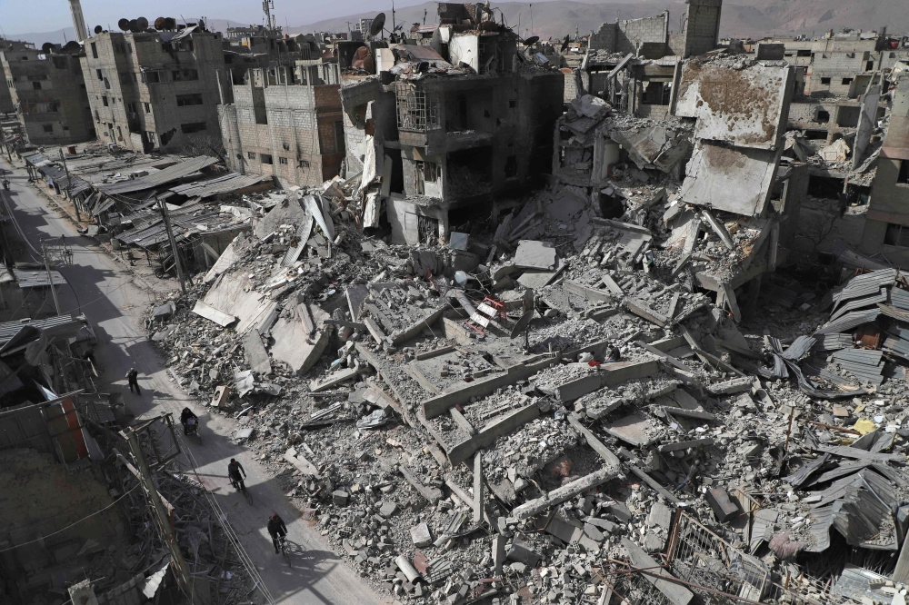 A general view shows several destroyed buildings in Douma, in the rebel enclave of Eastern Ghouta on the outskirts of Damascus. — AFP
