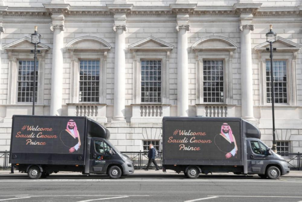 Vans featuring a welcome to Crown Prince Muhammad Bin Salman are parked in Whitehall in central London on Wednesday. — AFP