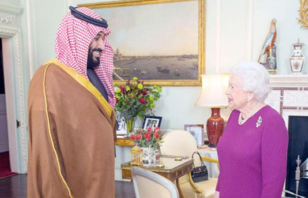 Britain's Queen Elizabeth II greets Crown Prince Muhammad Bin Salman, deputy premier and minister of defense, at Buckingham Palace in central London on Wednesday. — AFP