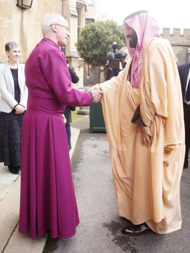 Britain's Archbishop of Canterbury Justin Welby greets Crown Prince Muhammad Bin Salman, deputy premier and minister of defense, as he arrives at Lambeth Palace in London, Thursday. — Reuters