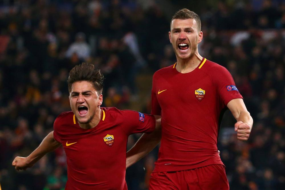 Roma's Edin Dzeko (R) celebrates with Cengiz Under after scoring against Shakhtar Donetsk during their Champions League Round of 16 second leg match at Stadio Olimpico in Rome Tuesday. — Reuters