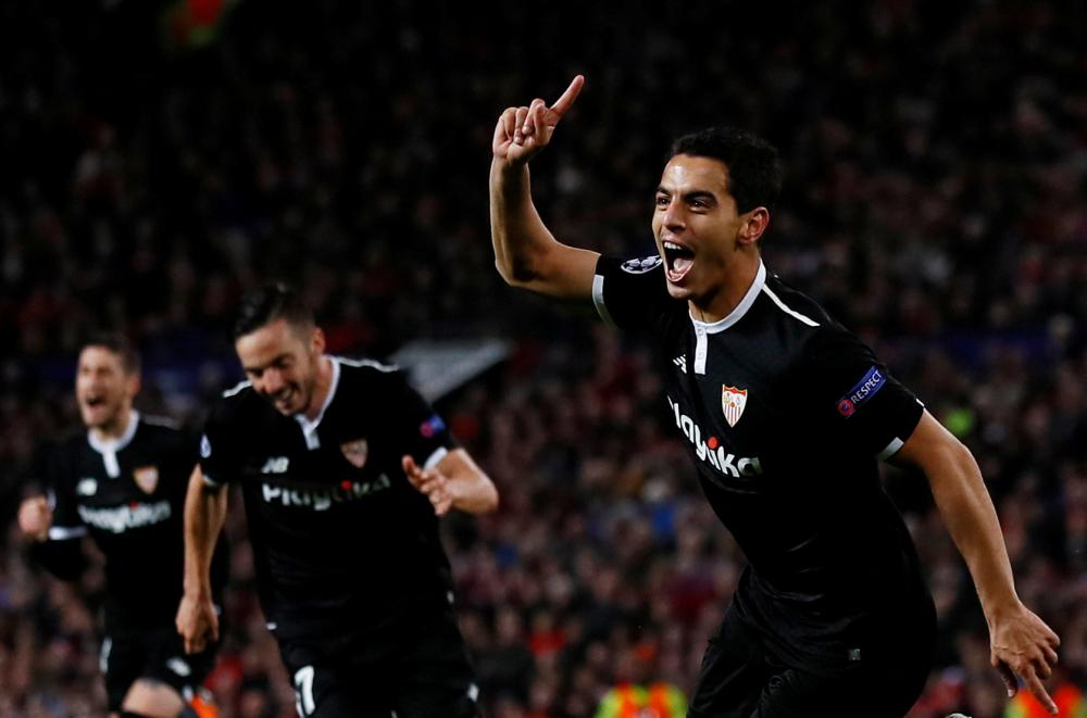 Sevilla's Wissam Ben Yedder celebrates scoring a goal against Manchester United during their Champions League Round of 16 second leg match at Old Trafford Tuesday. — Reuters