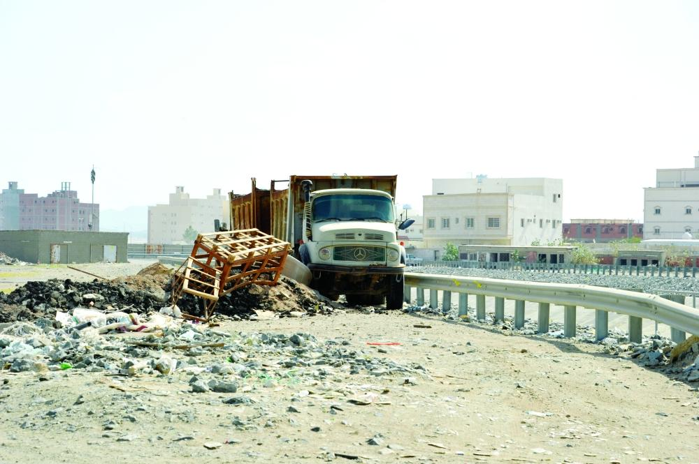 Contractors have turned empty plots in the district into dumping grounds for construction waste. — Photo courtesy Al-Madina