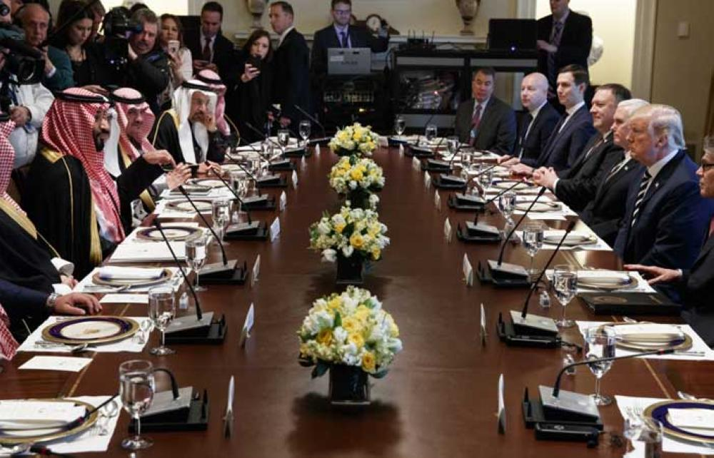 President Donald Trump listens as Saudi Crown Prince Muhammad Bin Salman speaks during a working lunch in the Cabinet Room of the White House, Tuesday, March 20, 2018, in Washington. — AP