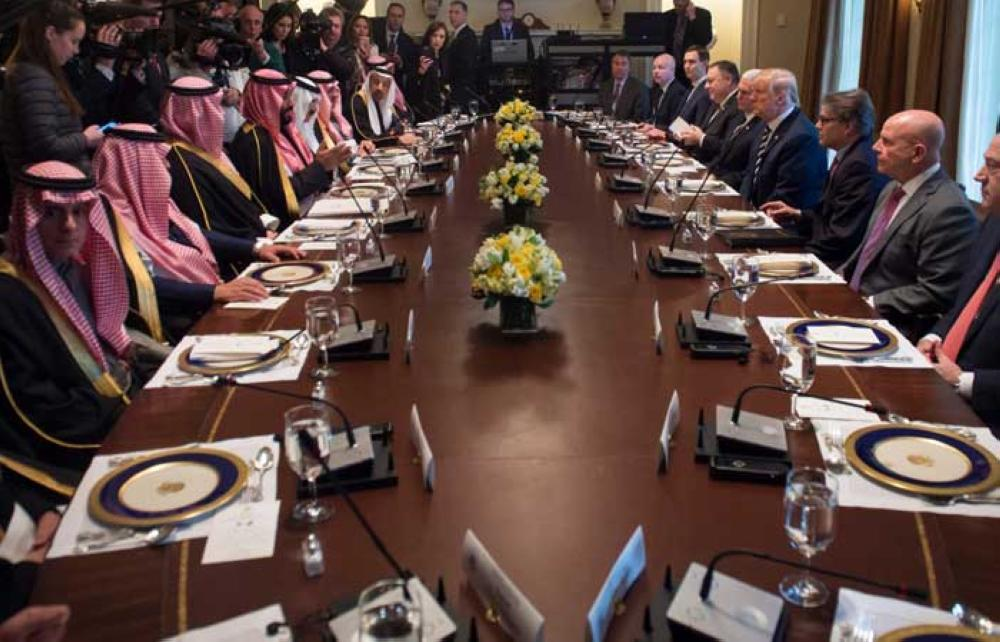 US President Donald Trump (center R) holds a lunch meeting with Saudi Arabia's Crown Prince Muhammad Bin Salman  (center L), and members of his delegation, in the Cabinet Room of the White House in Washington, DC, March 20, 2018. — AFP