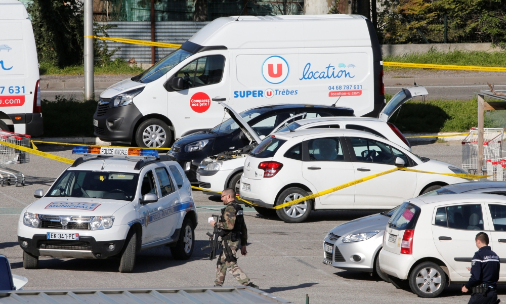 Police officers and investigators at a supermarket after a hostage situation in Trebes, France, on Friday. — Reuters