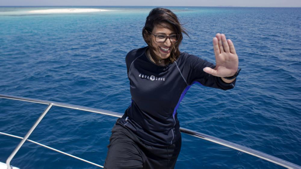 In this March 7 photo, Nouf Alosaimi, a 29-year-old Saudi diving instructor, prepares to explore the waters off a sandy island in the Red Sea near King Abdullah Economic City.