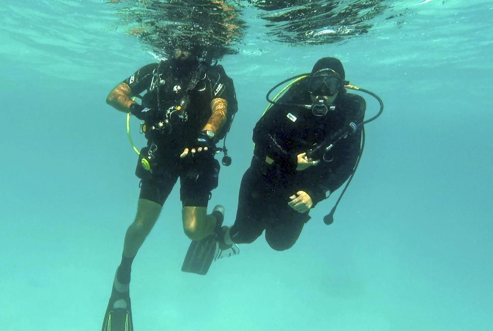 Nouf Alosaimi, left, and Tamer Nasr, an Egyptian diving instructor, exploring the Red Sea waters.
