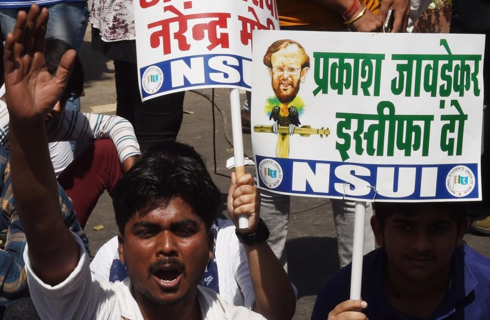 A member of the National Students Union of India (NSUI) shout slogans during a protest against Education Minister Prakash Javadekar in New Delhi on Friday. India on Thursday vowed to strengthen its online security after high school exam papers were leaked ahead of crucial tests, forcing millions of students to resit their finals. Education Minister Prakash Javadekar said an investigation was under way into how the mathematics and economics papers were accessed and spread via WhatsApp before the exam. — AFP