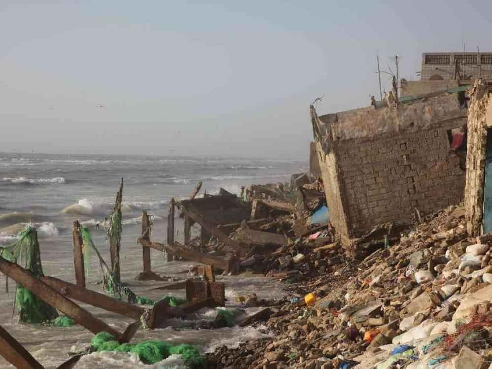 Buildings damaged by coastal erosion and rising sea levels in Saint-Louis, Senegal. - Thomson Reuters Foundation