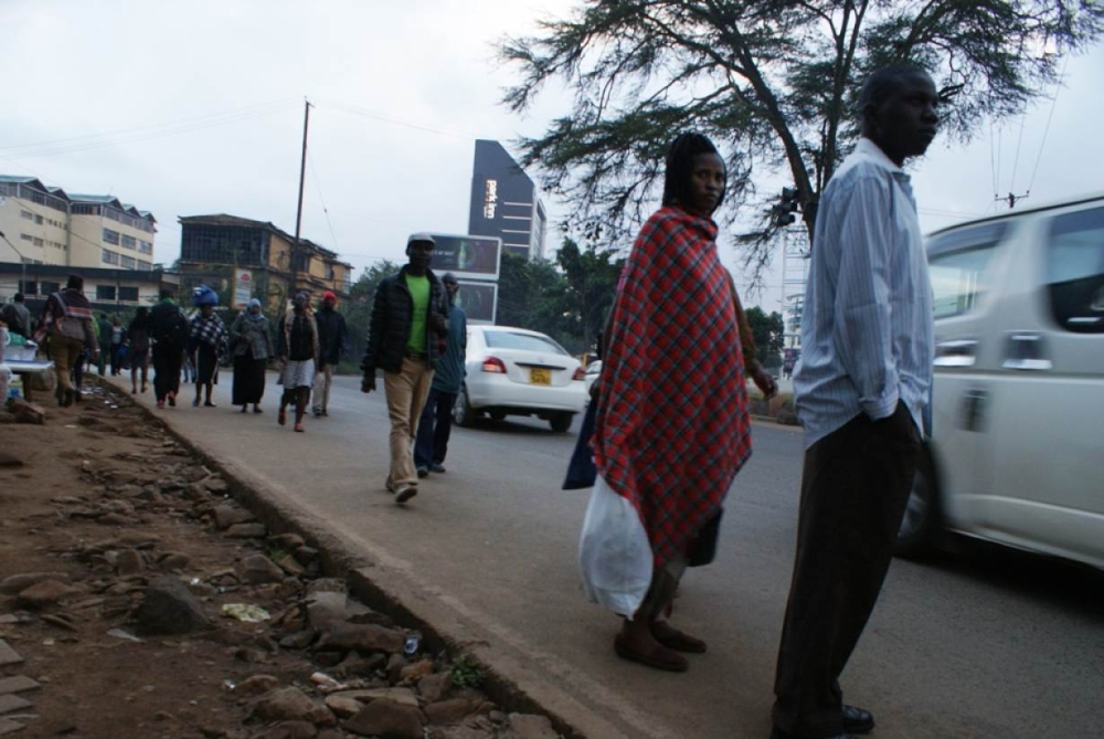 Pedestrians wait to cross Waiyaki Way on the northwest side of Nairobi. — Thomson Reuters Foundation photos