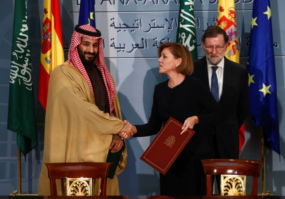 The Crown Prince shakes hands with Spain's Defense Minister Maria Dolores de Cospedal after signing a framework deal as Prime Minister Rajoy looks on at the Moncloa Palace in Madrid, Thursday. — Reuters