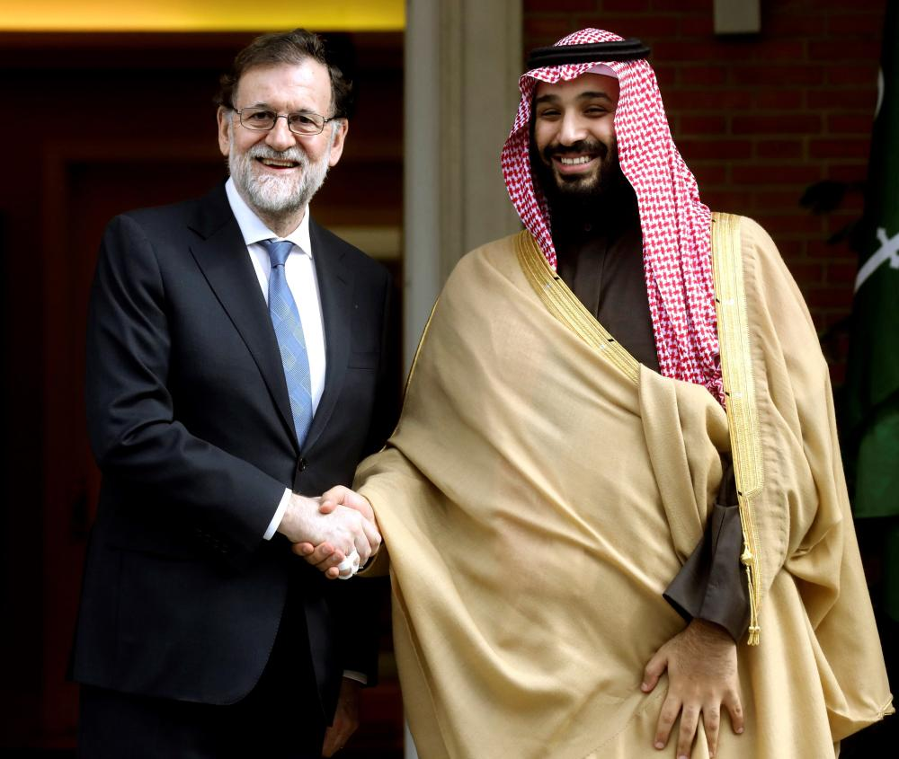 Crown Prince Muhammed Bin Salman, deputy premier and minister of defense, is welcomed by Spanish Prime Minister Mariano Rajoy for an official meeting at the Moncloa Palace in Madrid, Thursday. — EPA