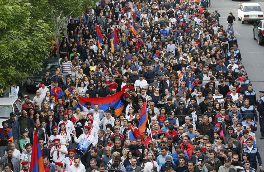 Armenian opposition supporters hold a rally in Yerevan, Armenia, on Sunday. — Reuters
