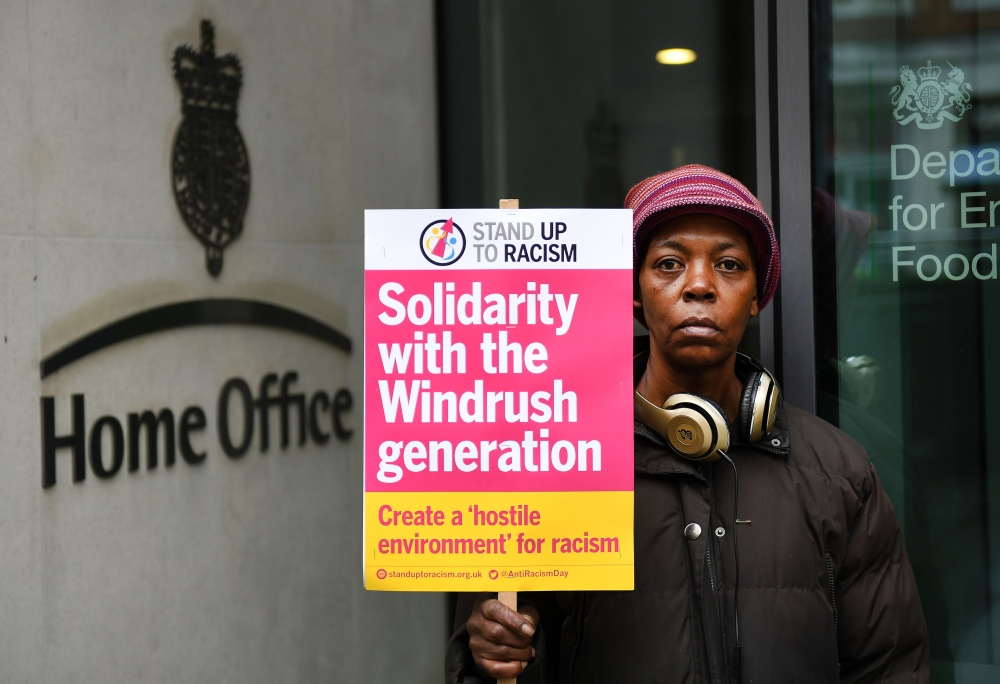 Londoner Marcia Fredericks, 53, stands outside the Home Office during a Windrush demonstration in London, Britain, on Saturday. — EPA