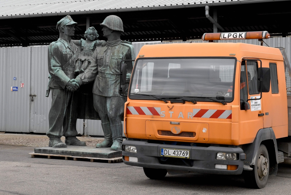 A monument dedicated to Soviet Red Army soldiers stands next to a truck on the grounds of a warehouse in the Polish town of Legnica, where the monument is being mothballed. Nearly three decades after the collapse of the Polish communist regime imposed by Russia, Poland's governing rightwing Law and Justice (PiS) party is bent on removing all vestiges from that era. From statues to street names, the government's strong nationalist views underpin an enduring aversion to communism, which it views as primarily a form of foreign domination. - AFP