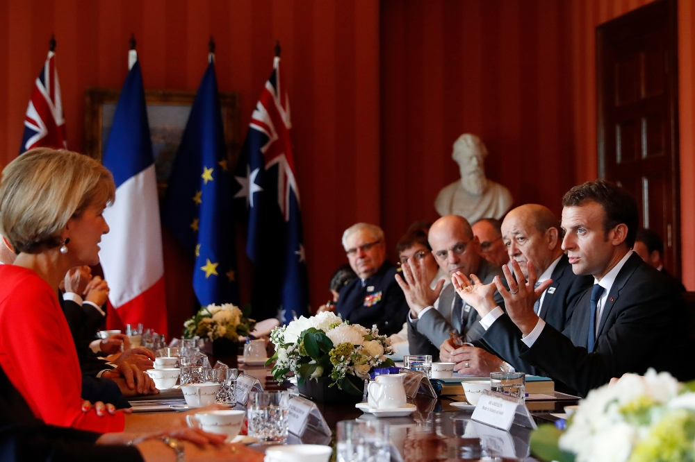 French President Emmanuel Macron, right, speaks with Australian Prime Minister Malcolm Turnbull and members of his Cabinet during a meeting at Admiralty House in Sydney, New South Wales, Australia, on Wednesday. — EPA
