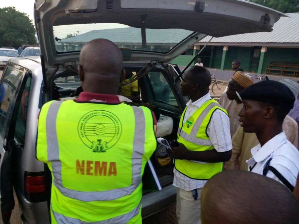 Members of the National Emergency Management Agency (NEMA) evacuate casualties from the site of blasts attack in Mubi, in northeast Nigeria, on Tuesday. — Reuters