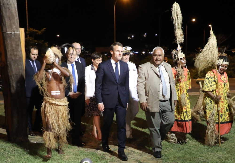 French President Emmanuel Macron (center) walks with President of the 'Senat Coutumier' Pascal Sihaze (center/right) French Foreign Affairs Minister Jean-Yves Le Drian (2nd left), High Commissioner in New Caledonia Thierry Lataste (rear) and others as he arrives to attend a welcoming ceremony at The Coutumier Senate in Noumea, Thursday. Macron's plane landed in Noumea, New Caledonia, for the second leg of the president's trip to the Pacific, six months before the referendum on the independence of the island. — AFP